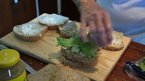 Assembling delicious sandwiches at mac's pizzeria stock video footage