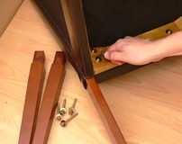 Assembling furniture. A closeup view of a pieces or components of prefabricated furniture being put together Royalty Free Stock Photo
