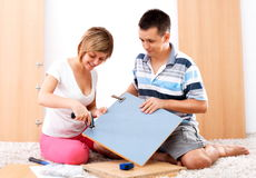 Assembling furniture Royalty Free Stock Image