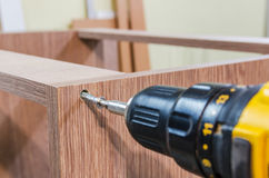 Assembling of furniture power tools Stock Photos