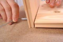 Assembling furniture Stock Image
