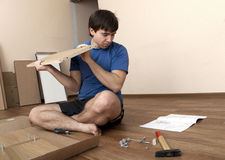 Assembling furniture Stock Images