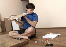 Assembling furniture Stock Images