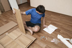 Assembling furniture Stock Photos