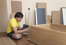 Assembling furniture Royalty Free Stock Photography