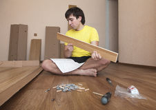 Assembling furniture Royalty Free Stock Photo