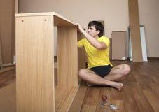 Assembling furniture Royalty Free Stock Photos