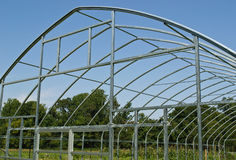 Assembling a Greenhouse. A greenhouse under construction, showing assembled structural members in Prince Frederick, Maryland USA stock image