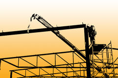 Assembling iron construction-silhouette worker Royalty Free Stock Photo
