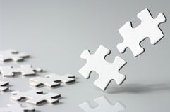 Assembling a jigsaw puzzle. Royalty Free Stock Photo