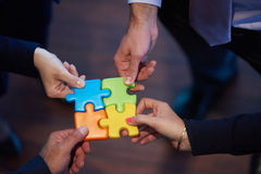Assembling jigsaw puzzle Royalty Free Stock Images