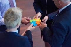 Assembling jigsaw puzzle Stock Photos