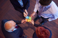 Assembling jigsaw puzzle Stock Photography