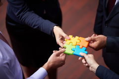 Assembling jigsaw puzzle Royalty Free Stock Photos