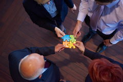 Assembling jigsaw puzzle Royalty Free Stock Photo