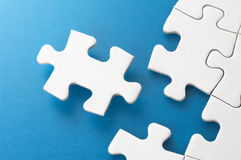 Assembling jigsaw puzzle pieces. Stock Photos