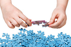Assembling of jigsaw puzzles isolated Royalty Free Stock Photos