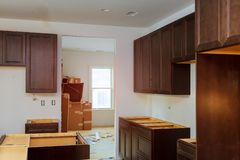 Assembling on kitchen cabinets remodel furniture installation cabinet. Assembling on kitchen cabinets remodel furniture installation installing length royalty free stock photos