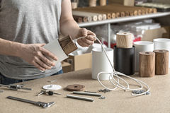 Assembling of lamp in workshop Royalty Free Stock Photo