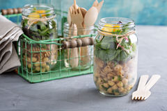 Assembling a mason jar salad. For a lunch to go Royalty Free Stock Photo