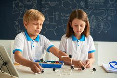 Assembling molecular model. School children assembling molecular model at the class Royalty Free Stock Images