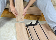Assembling a New Drawer Shoe Rack. Man assembling parts of a new shoe rack drawer royalty free stock photo