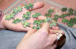 Assembling the puzzle Royalty Free Stock Image
