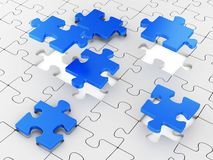 Assembling puzzles Royalty Free Stock Photo