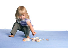 Assembling shells young girl Stock Photography