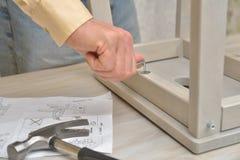Assembling the stool Stock Photos