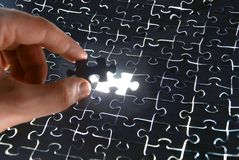 Assembling The Puzzle Stock Photos