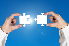 Assembling two blank puzzles together Royalty Free Stock Image