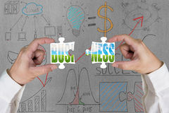 Assembling two puzzles for green business with doodles Stock Image