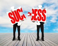 Assembling two puzzles for success Stock Images