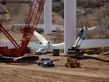 Assembling windmill. Assembling a large windmill various activities with cranes and trucks Royalty Free Stock Photos