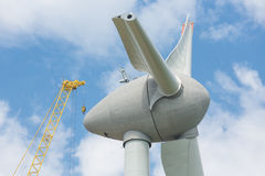 Assembling wings Dutch windturbine with large crane Stock Photo