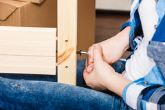 Assembling wood furniture using hex key. DIY. Royalty Free Stock Photos