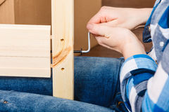 Assembling wood furniture using hex key. DIY. Royalty Free Stock Photography