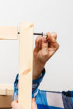 Assembling wood furniture using hex key. DIY. Stock Photography