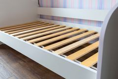 Assembling wooden bed. In childrens room Stock Photos