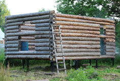 Assembling a wooden frame and building a house. Russia. Texture of old wooden logs. Assembling a wooden frame and building a house. Russia. Texture of old stock images