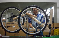 Assembly bicycle bike from Indonesia. SIDOARJO, INDONESIA - APRIL 9, 2015: Workers check on the assembly line at the assembly bicycle bike from Indonesia Polygon royalty free stock photo