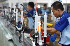 Assembly bicycle bike from Indonesia. SIDOARJO, INDONESIA - APRIL 9, 2015: Workers check on the assembly line at the assembly bicycle bike from Indonesia Polygon Royalty Free Stock Image