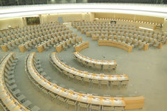 Assembly chamber. The Human Rights and Alliance of Civilizations Room with chairs and tables put up in concentric semicircles of United Nations in Geneva Royalty Free Stock Image