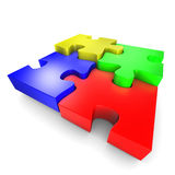 The assembly of colored pieces of puzzle. Symbolises a process or a team cohesion and its interactions Stock Photos