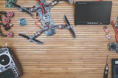 Build drone parts. Assembly drone accessories quadcopter on a wooden background, space for ads and inscriptions Royalty Free Stock Photo