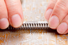 Assembly of electronic components on circuit board Royalty Free Stock Photography