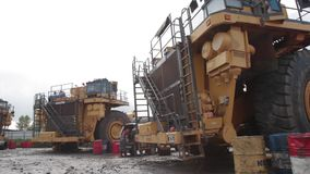 Assembly of heavy dump trucks. In the open pit stock video