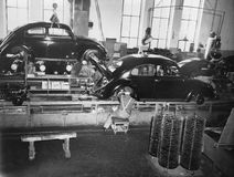 ASSEMBLY LINE. (All persons depicted are no longer living and no estate exists. Supplier grants that there will be no model release issues royalty free stock photos