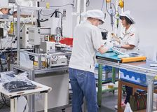Assembly line at factory in Japan, 26.08.2017. Workers at assembly line at consumer goods manufacturing factory in Japan, 26.08.2017 Stock Photos